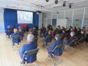 Year 5 & Year 6 listening attentively to Katherine Rundell