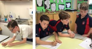 Year 6 working in design teams to start their work on a new board game